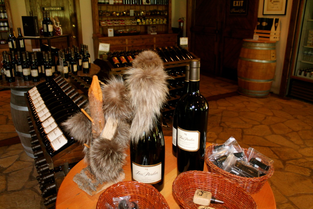 Raccoon skin caps adorn the wine bottles and shelves as a tribute to founder Fess Parker, aka Davy Crockett